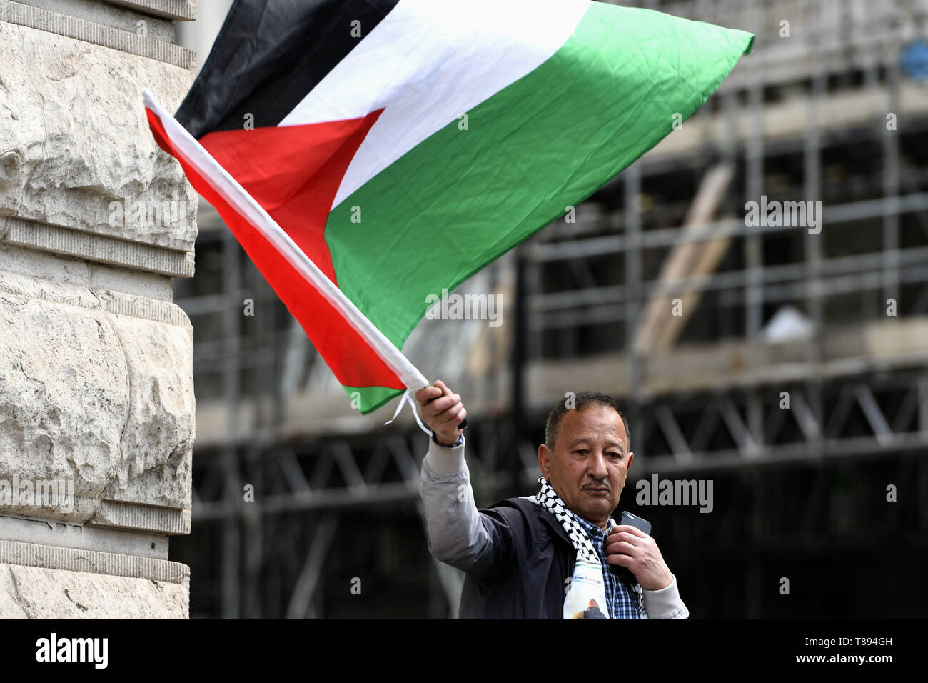 London, Greater London, UK. 11th May, 2019. A protester is seen holding a Palestinian flag during the demonstration.Palestinian human rights activist Ahed Tamimi joined the National demo for Palestine. Protesters gathered at Portland Place and marched to Whitehall in London, joining a global demonstration to show solidarity for Palestinian citizens and also to demand respect for the Palestinians rights and defend the rights to return to their territory. Credit: Andres Pantoja/SOPA Images/ZUMA Wire/Alamy Live News Stock Photo