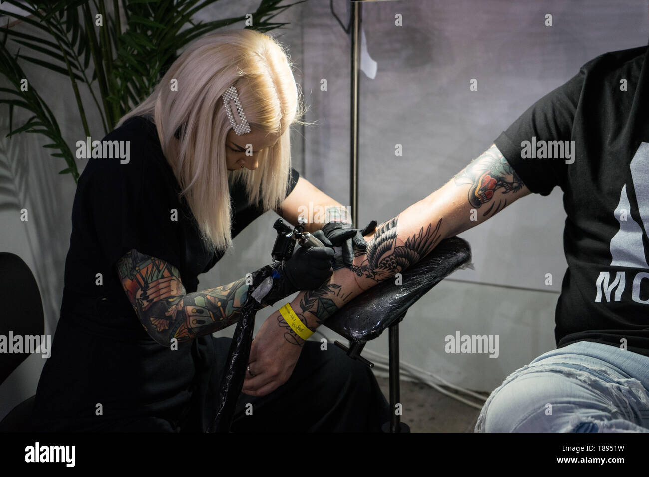 May 10, 2019: Athens, Greece: A tattoo artist seen making a tattoo during the event.The Athens Tattoo Convention is a three day annual convention about tattoo and it takes place in Athens, Greece. It has been recognized as one of the best in Europe with visitors from all over the world who come exclusively for the Athens Tattoo Convention experience and also to meet some of the world's most respected tattoo artists. Credit: Nikos Pekiaridis/SOPA Images/ZUMA Wire/Alamy Live News - Stock Image