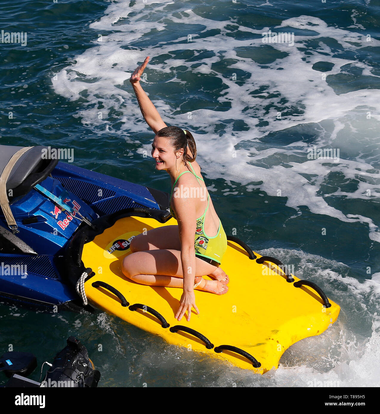 Dun Laoghaire, Dublin, Ireland. 11th May, 2019. Red Bull Cliff Diving World Series, rounds 1 and 2; Iris Schmidbauer (GER) waves to the crowd after completing her dive Credit: Action Plus Sports/Alamy Live News - Stock Image