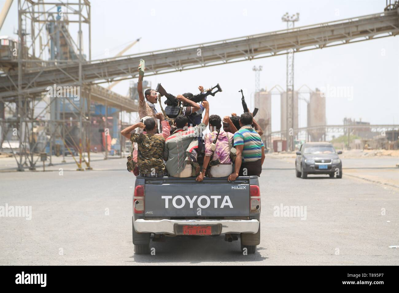 (190511) -- HODEIDAH (YEMEN), May 11, 2019 (Xinhua) -- Houthi members ride a truck during their withdrawal at Salif port in Hodeidah, Yemen, on May 11, 2019. Yemen's Houthi rebels began on Saturday withdrawal from two ports of Hodeidah Province, eyewitnesses said. (Xinhua) Stock Photo