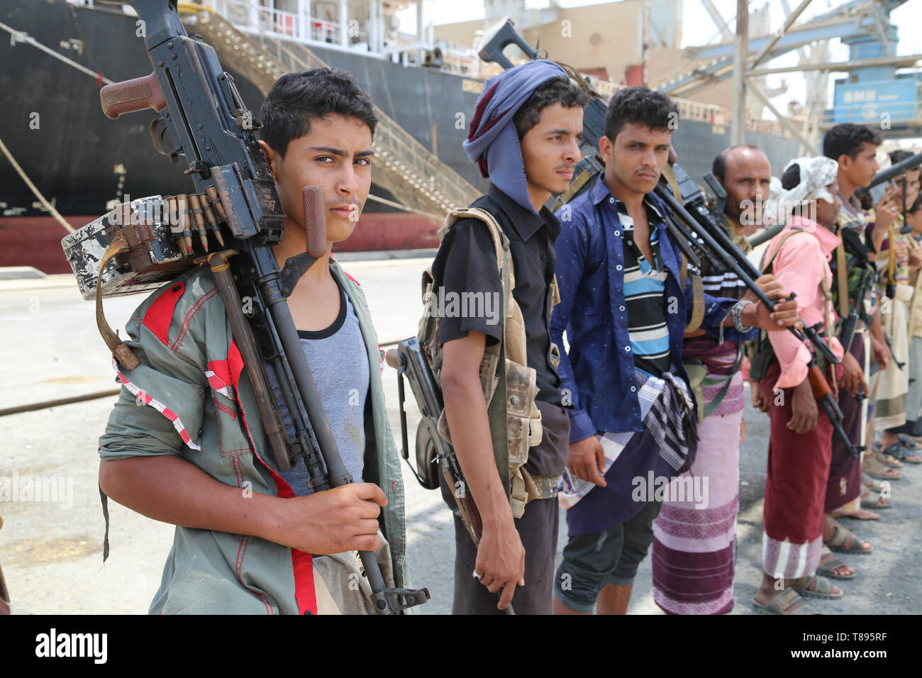 (190511) -- HODEIDAH (YEMEN), May 11, 2019 (Xinhua) -- Houthi members are seen during their withdrawal from Salif port in Hodeidah, Yemen, on May 11, 2019. Yemen's Houthi rebels began on Saturday withdrawal from two ports of Hodeidah Province, eyewitnesses said. (Xinhua) Stock Photo