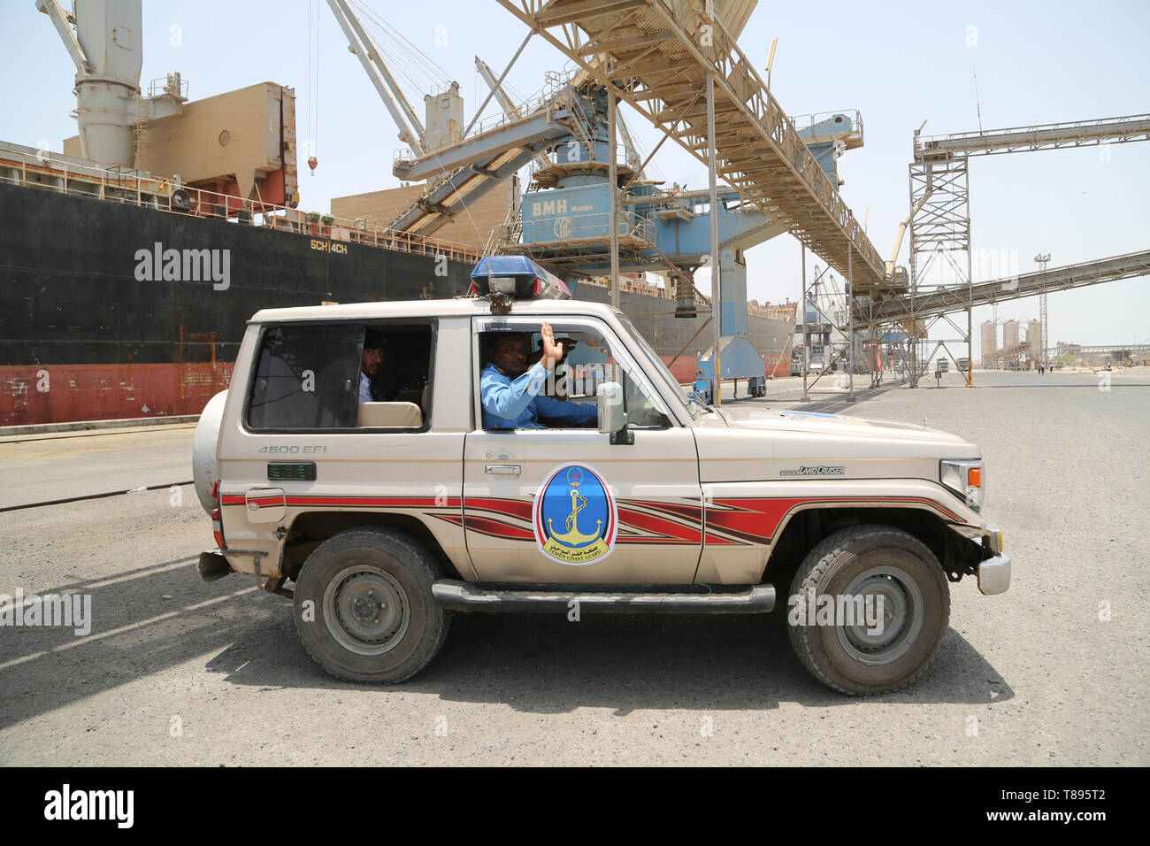 (190511) -- HODEIDAH (YEMEN), May 11, 2019 (Xinhua) -- Members of local coast guard work at Salif port following the withdrawal of Houthi rebels, in Hodeidah, Yemen, on May 11, 2019. Yemen's Houthi rebels began on Saturday withdrawal from two ports of Hodeidah Province, eyewitnesses said. (Xinhua) Stock Photo