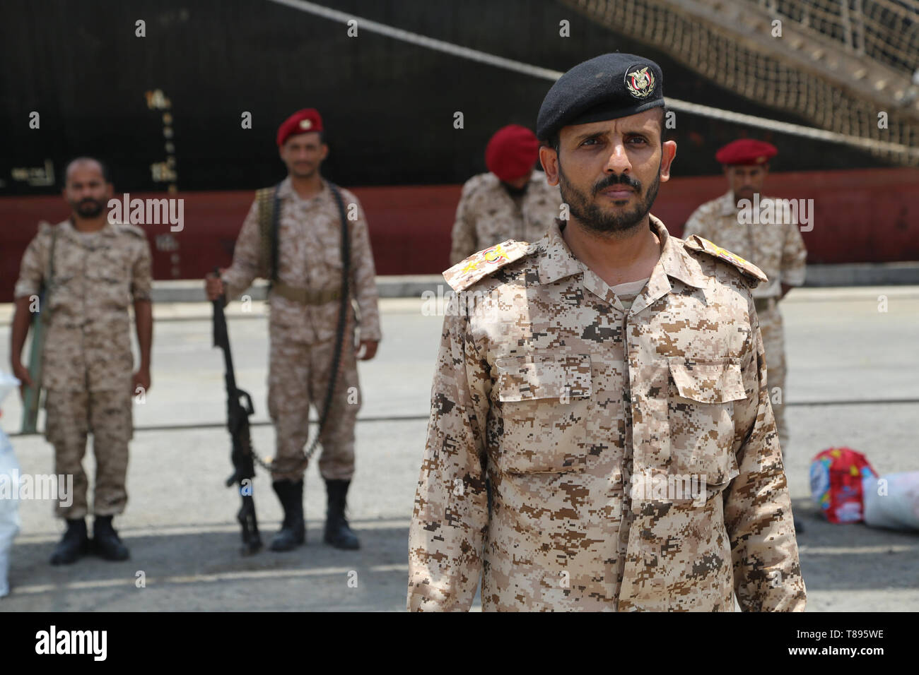 (190511) -- HODEIDAH (YEMEN), May 11, 2019 (Xinhua) -- Houthi members stand at attention during their withdrawal from Salif port in Hodeidah, Yemen, on May 11, 2019. Yemen's Houthi rebels began on Saturday withdrawal from two ports of Hodeidah Province, eyewitnesses said. (Xinhua) Stock Photo