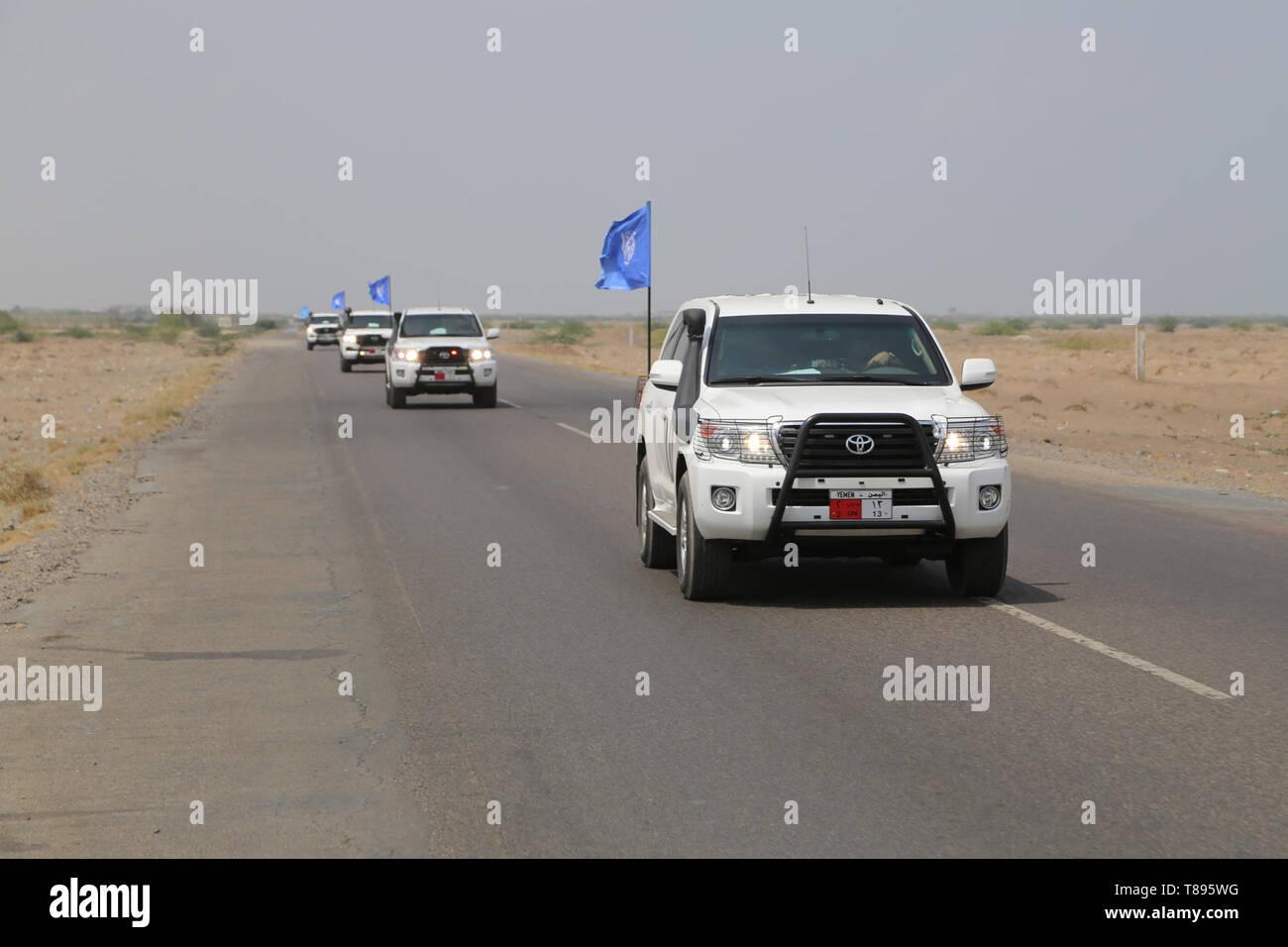 (190511) -- HODEIDAH (YEMEN), May 11, 2019 (Xinhua) -- UN vehicles are seen on their way to Salif port in Hodeidah, Yemen, on May 11, 2019. Yemen's Houthi rebels began on Saturday withdrawal from two ports of Hodeidah Province, eyewitnesses said. (Xinhua) Stock Photo