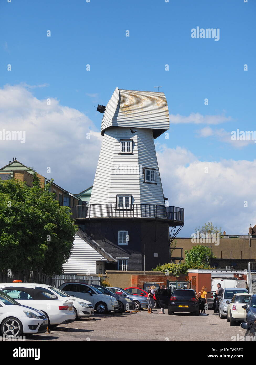 Sheerness, Kent, UK. 12th May, 2019. National Mills Weekend is the annual festival celebrating the UK's milling heritage. Pictured is Watson's Mill (formerly the Great Mill) in Sheerness which lies close to the town centre. Since 1924 the mill stood in ruin after being demolished, until being rebuilt by Caleb Watson in 2006, with fire almost destroying the rebuild in 2008 before it was due to be finished. It's a prominent local landmark but not open to the public; the ground floor has been taken over by a local insurance company. It's a Grade II  smock mill. Credit: James Bell/Alamy Live News - Stock Image
