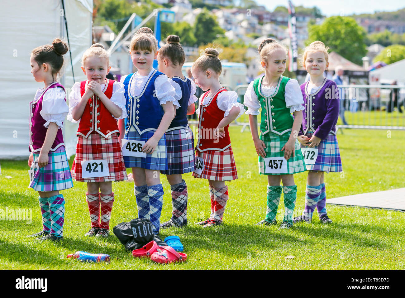 Gourock, UK 12th May 2019. The Highland Games season begins with the Gourock Highland Games at Battery Park, Gourock and features Pipe Band competitions, traditional Scottish Heavy athletics such as throwing the 16 pound weight and highland dancing with competitors as young as 5 years. This year there was an international list of competitors from countries including Poland and America Credit: Findlay/Alamy Live News Stock Photo