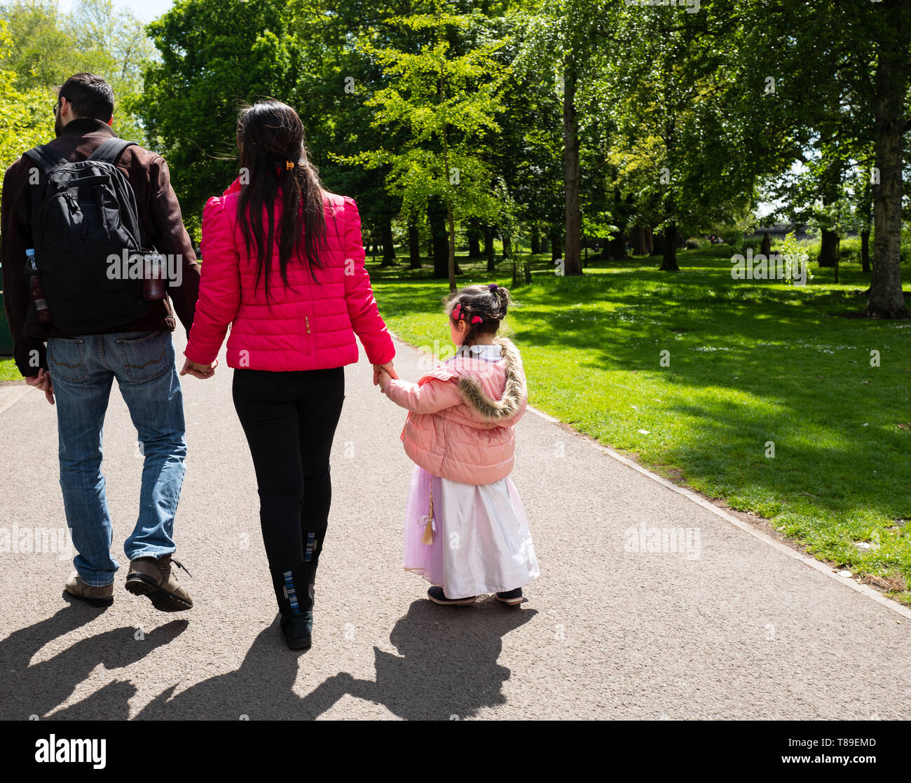 Family walking in the park - Stock Image