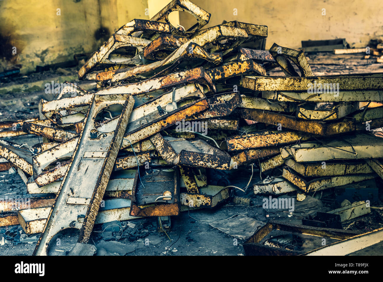 Pile of rusted old steel in an abandoned factory in Belarus Chernobyl exclusion zone, - Stock Image