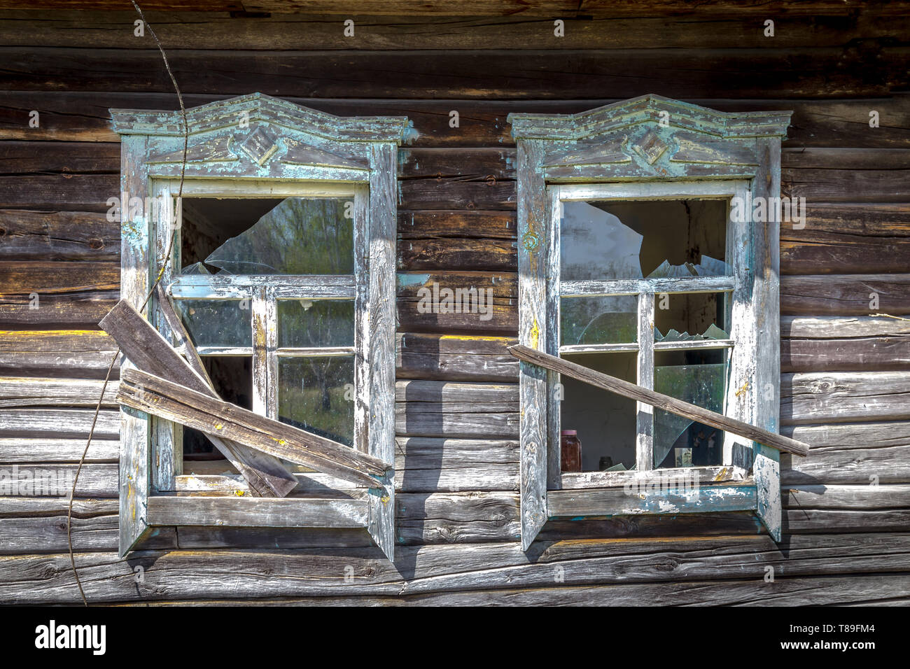 Windows with broken glass of an old abandoned house in Belarus Chernobyl exclusion zone in Belarus - Stock Image