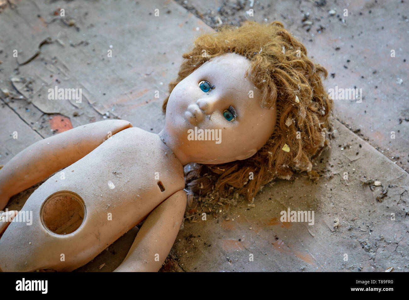 Abandoned child doll in a abandoned house in Belarus Chernobyl exclusion zone, - Stock Image