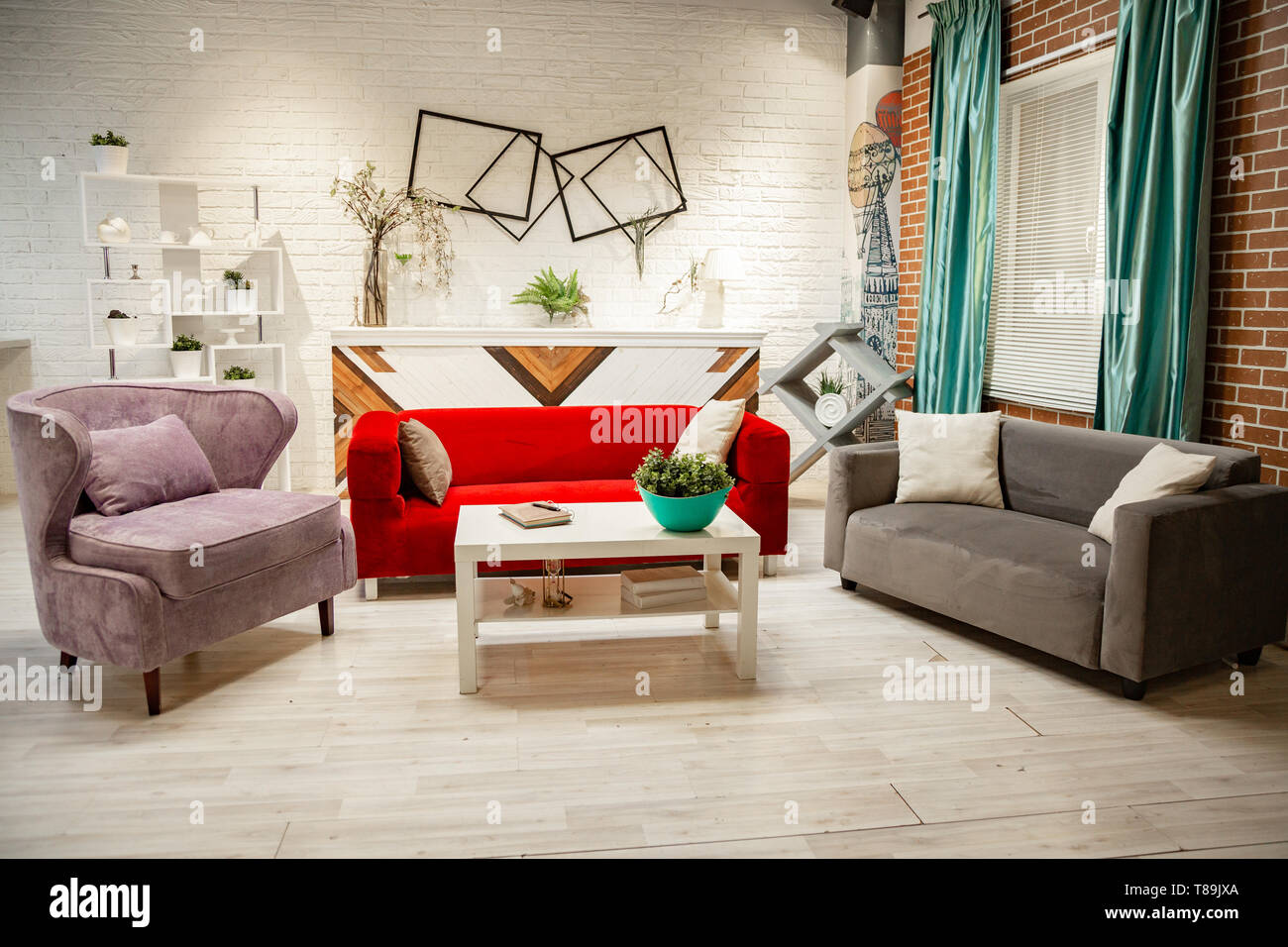 Photo studio in the style of the living room. Classic furniture, sofa, armchairs fireplace. Stock Photo