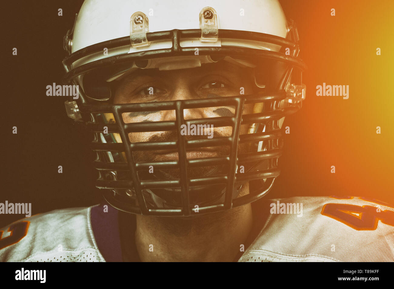 Portrait close-up, American football player, bearded in helmet. Concept American football, patriotism, close-up. - Stock Image
