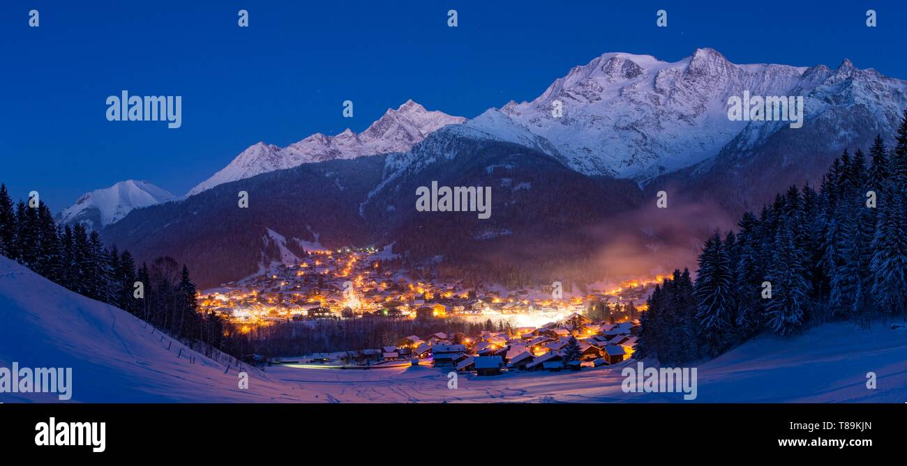 France, Haute Savoie, Massif of the Mont Blanc, the Contamines Montjoie, the panorama on the village in the twilight and summits of the massif of the Mont Blanc from left to right, mount Vorassay Tricot pass, Tricot needle, in the center Bionnassay needle, Miage dome(3673m and Berangere needle - Stock Image