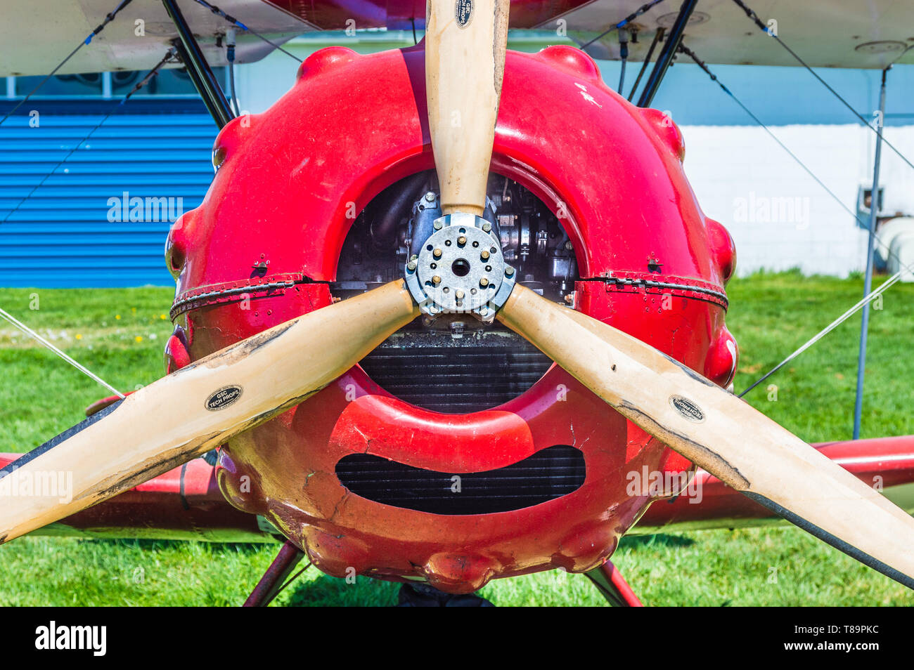 Propeller and nose of red vintage Murphy Renegade bi-plane at Delta Heritage Airpark. - Stock Image