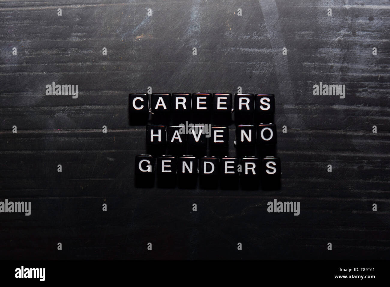 Careers have no genders on wooden blocks. Education, Motivation and inspiration concept - Stock Image