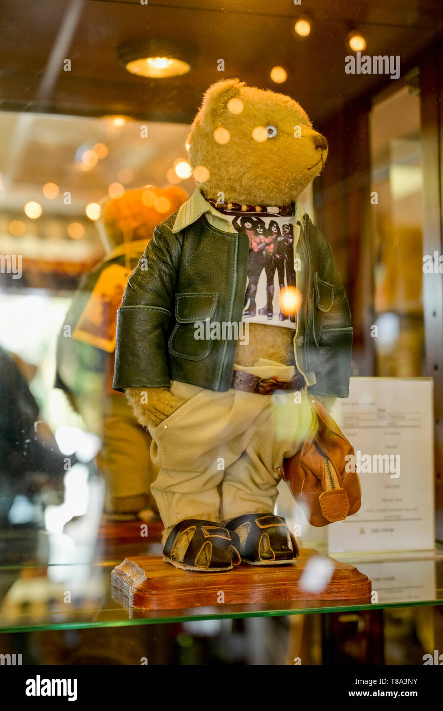 One of a kind Teddy bear wearing Kiss T shirt,  in case, Fort Langley, BC, Canada Stock Photo