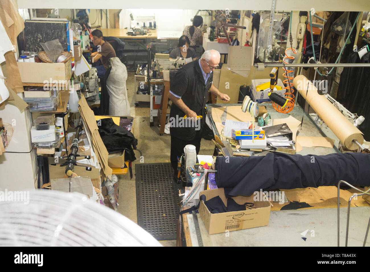 Perth, Western Australia, Australia - 17/01/2013 : People working in a clothing repair company with leather, Sinikka Custom Made Garments, Alteration - Stock Image