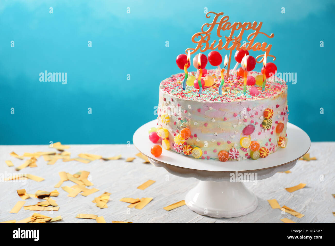 Miraculous Stand With Beautiful Tasty Birthday Cake On Table Against Color Funny Birthday Cards Online Elaedamsfinfo