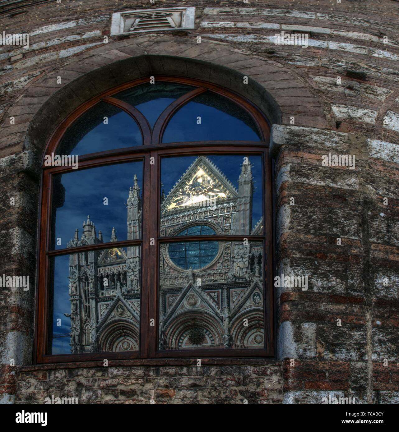 Santa Maria del Fiore; the cathedral of Florence reflected in neighbouring windows Stock Photo