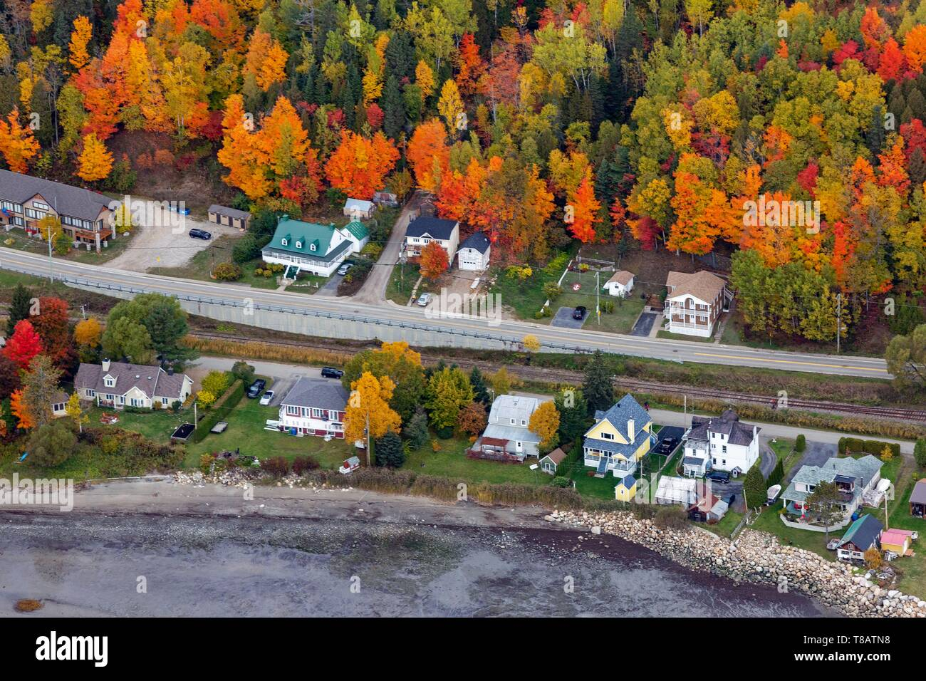 Canada, Province of Quebec, Charlevoix Region, Saint-Joseph-de-la-Rive, houses on the banks of the St. Lawrence River (aerial view) Stock Photo