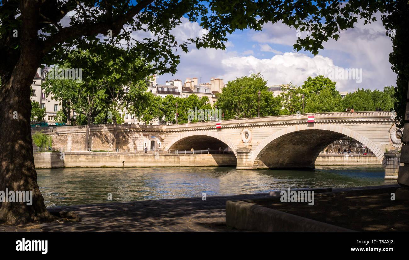 Parisian bridge and the Seine river seen from Saint Louis island in Paris - Stock Image
