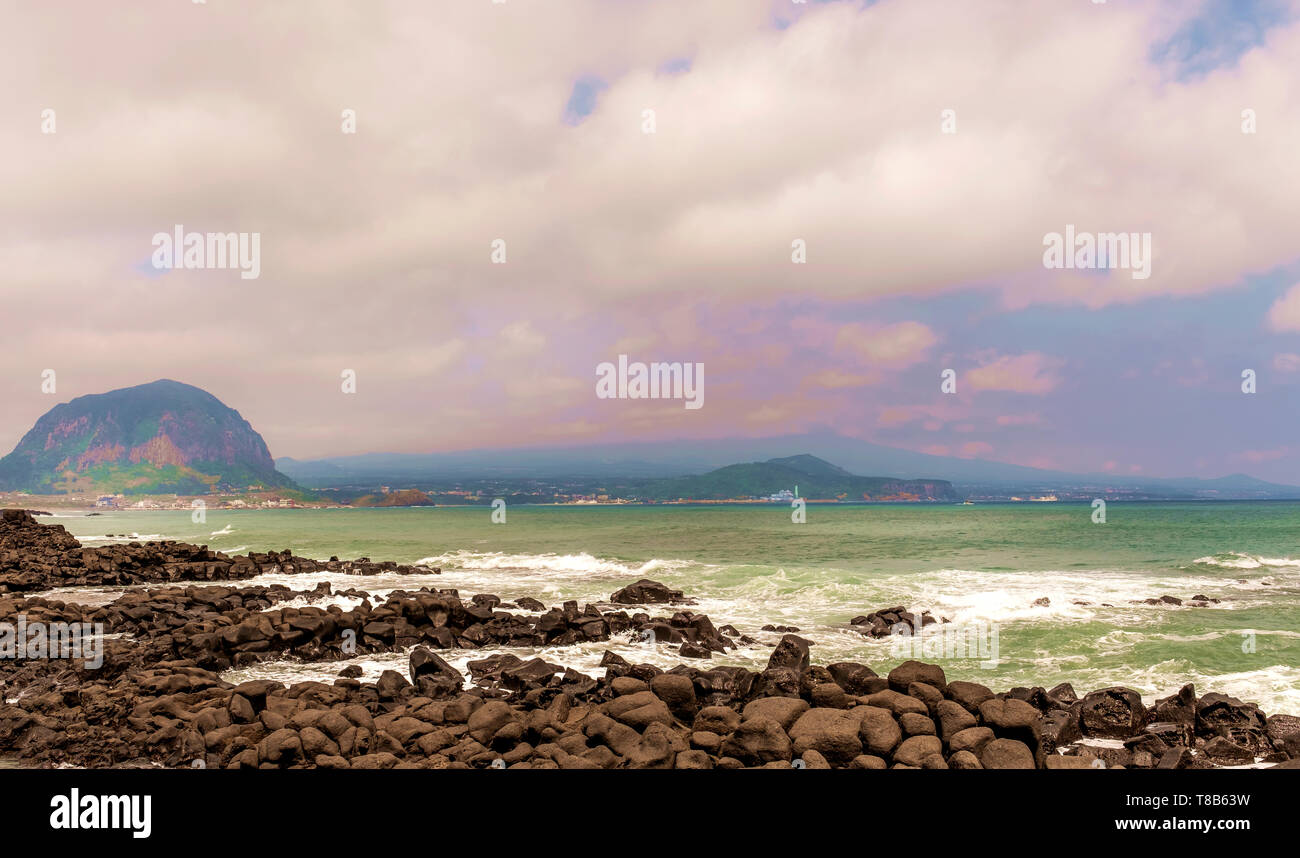landscape view with cloud and blue sky in the sea, Jeju, South Korea - Stock Image