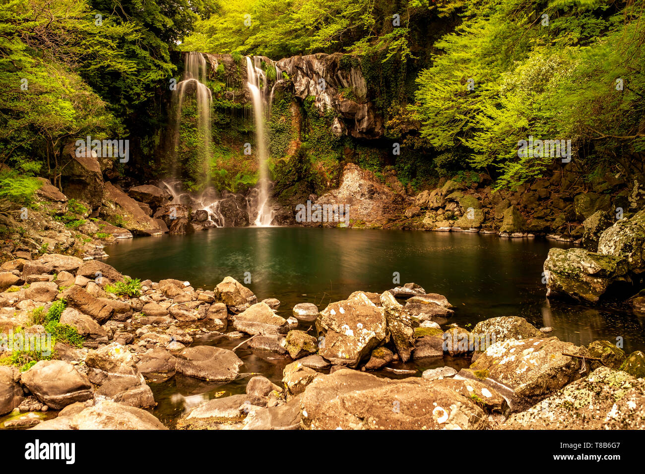 long exposure in the waterfall, Jeju, South Korea - Stock Image