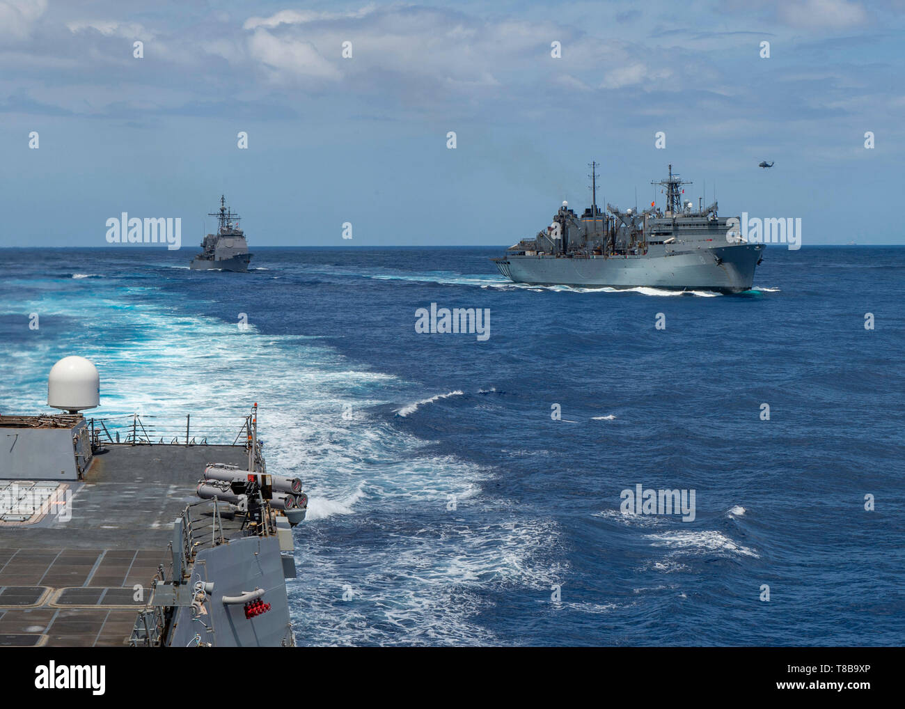 190508-N-SS350-0282 MEDITERRANEAN SEA (May 8, 2019) The Ticonderoga-class cruiser USS Leyte Gulf (CG 55) pulls alongside the fast combat support ship USNS Arctic (T-AOE 9) after the Arleigh Burke-class guided-missile destroyer USS Bainbridge (DDG 96) completed its replenishment-at-sea. Bainbridge is underway as part of the Abraham Lincoln Carrier Strike Group (ABECSG) deployment in support of maritime security cooperation efforts in the U.S. 5th, U.S. 6th and U.S. 7th Fleet areas of operation. With Abraham Lincoln as the flagship, deployed strike group assets include staffs, ships and aircraft Stock Photo