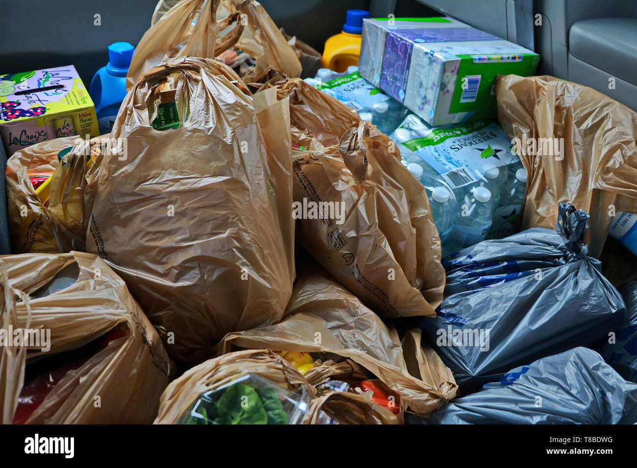 a bunch of groceries in the back of minivan - Stock Image