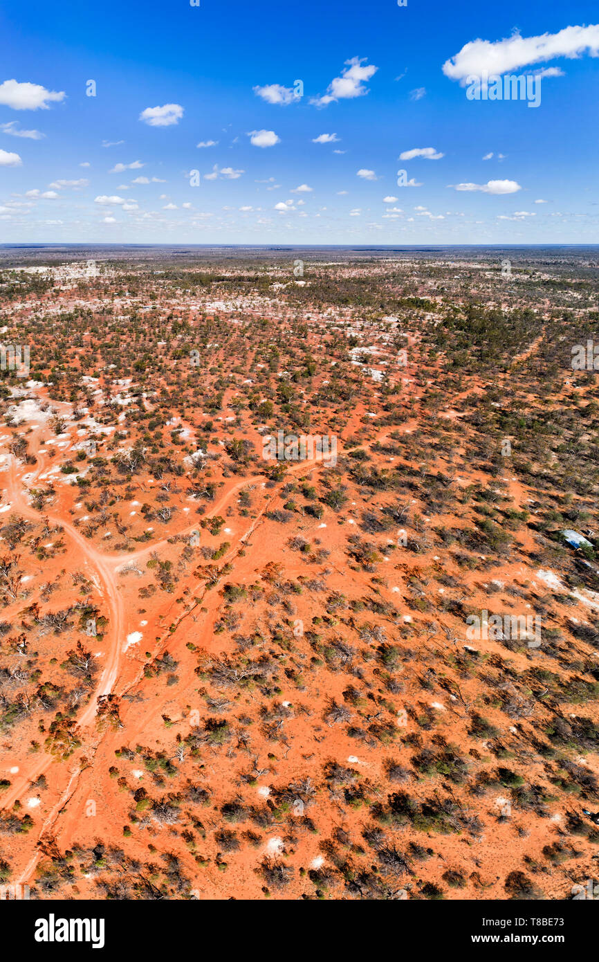 Red soils of Australian Outback around Lightning Ridge town - the centre of opal mining and black opals mines in Australia. Elevated aerial vertical p - Stock Image
