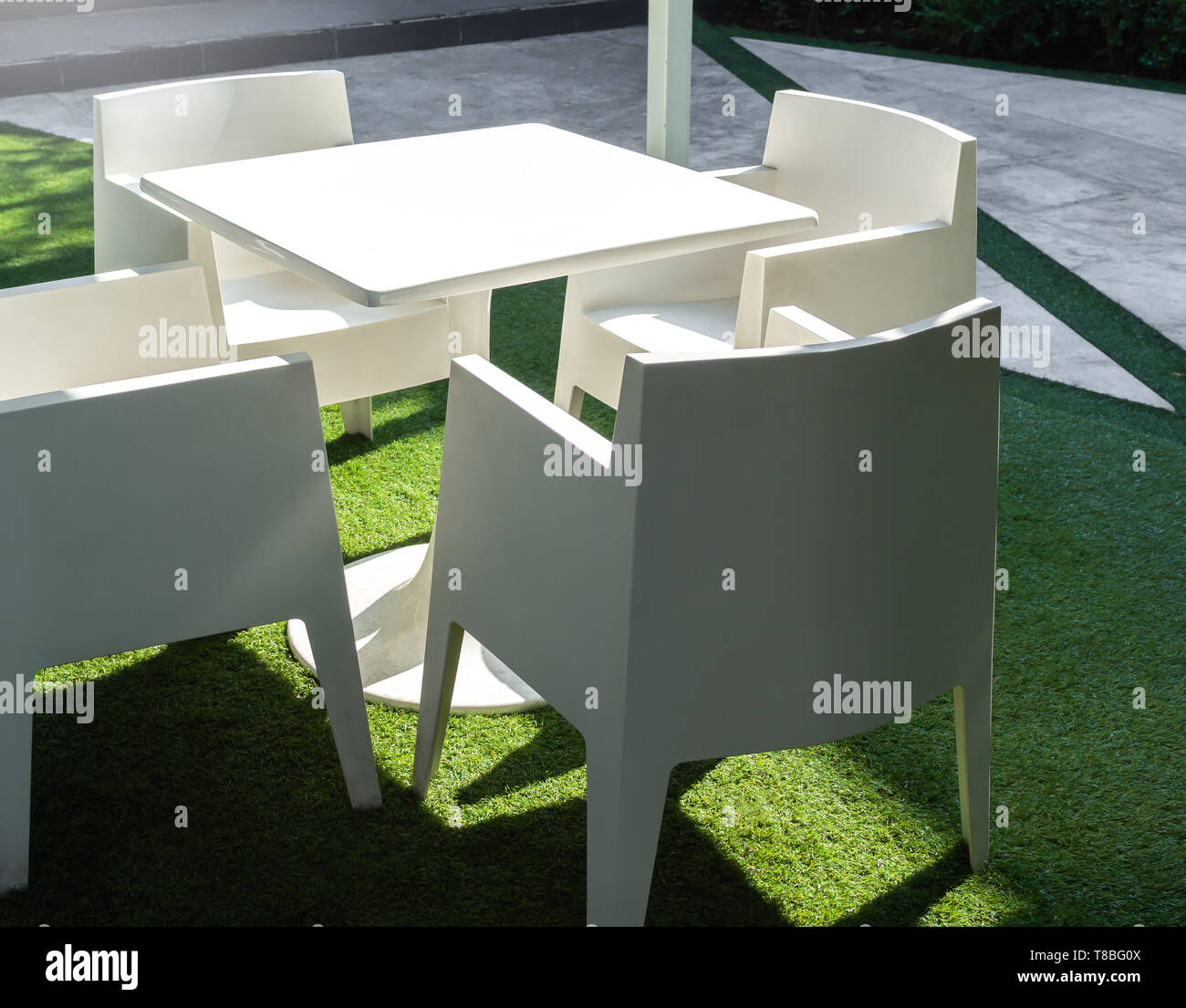 Fantastic White Modern Garden Dining Table And Four Chairs On Green Evergreenethics Interior Chair Design Evergreenethicsorg