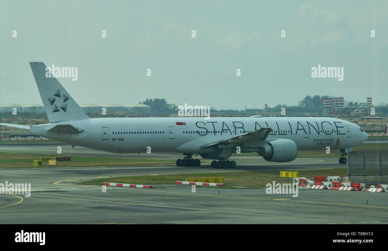 Singapore - Mar 28, 2019. 9V-SWI Singapore Airlines Boeing 777-300ER (White Star Alliance) taxiing on runway of Singapore Changi Airport (SIN). - Stock Image