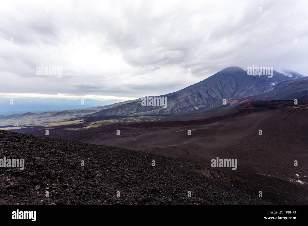 Dramatic view near Volcano Tolbachik. Lava fields. Russia, Kamchatka Peninsula - Stock Image