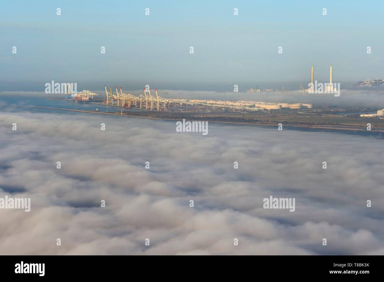 France, Seine Maritime, Le Havre, the port of Le Havre emerges from a sea of clouds - Stock Image