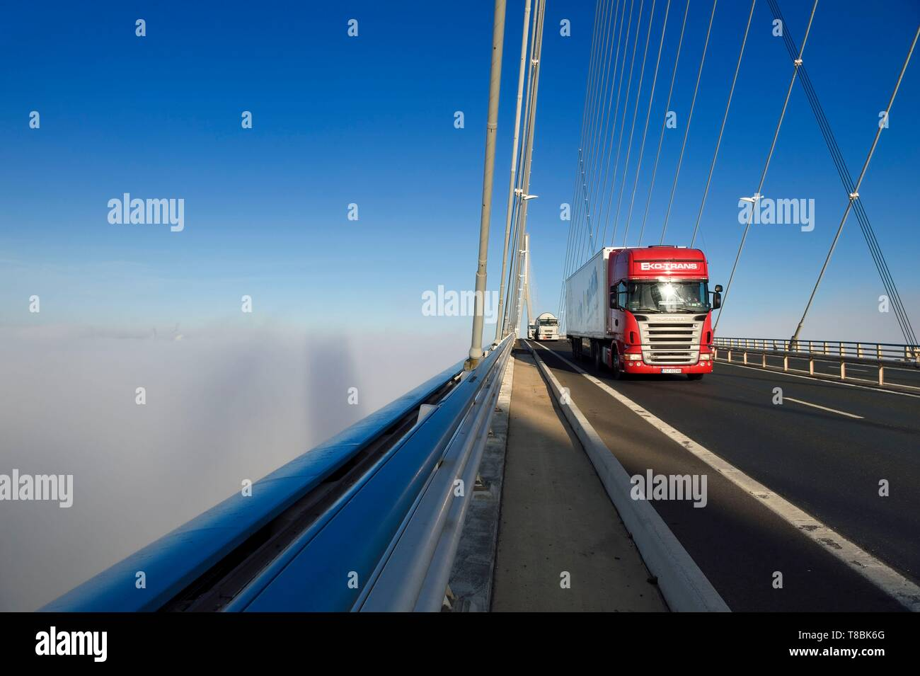 France, between Calvados and Seine Maritime, the Pont de Normandie (Normandy Bridge) spans the Seine in the Fog - Stock Image