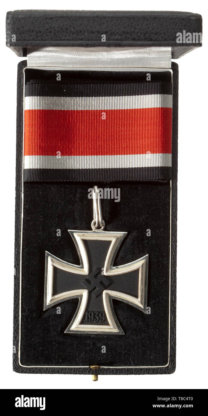 """The Estate of Knight's Cross winner Wolfgang Stumpf (1914 - 1943) Knight's Cross of the Iron Cross of 1939, the so-called """"Micro 800"""" Type A by maker Steinhauer & Lück. Blackened iron centre, """"frosted"""" silver frame with the small """"800"""" fineness mark, the suspension ring likewise punched """"800"""". Size 48 x 69 mm. Weight 30.11 g. With the original black award presentation case and a laid-in 73 cm length of orders ribbon. A coherent set in a mint state of preservation. Also an Iron Cross 1st Class of 1939 with case, an Iron Cross 2nd Class of 1939 with award envelope, a War Meri, Editorial-Use-Only Stock Photo"""