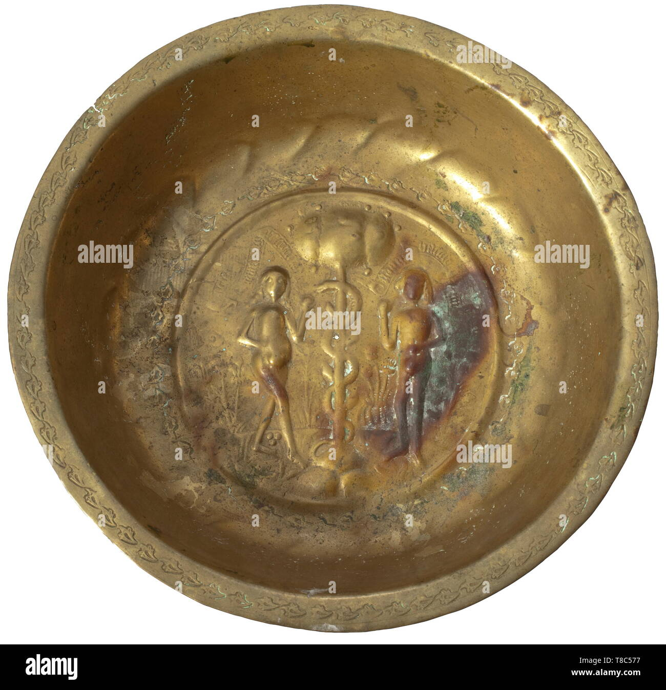 An alms dish, Nuremberg, 1st half of the 16th century Deep bowl made from brass with chased and punched decoration. The center with depiction of the Fall of Man with Adam and Eve under the tree of knowledge, above that two banners with inscription in Gothic minuscules 'EWA MACHT DEN ANFANG DES GEBRUCHS - ADAM HAT GEBROCHEN DAS GEBOT' (Eve induced the infringement - Adam broke the commandment). The center and the border with continuous frieze made from leaf marks. Diameter 27.5 cm. historic, historical, handicrafts, handcraft, craft, object, objec, Additional-Rights-Clearance-Info-Not-Available - Stock Image