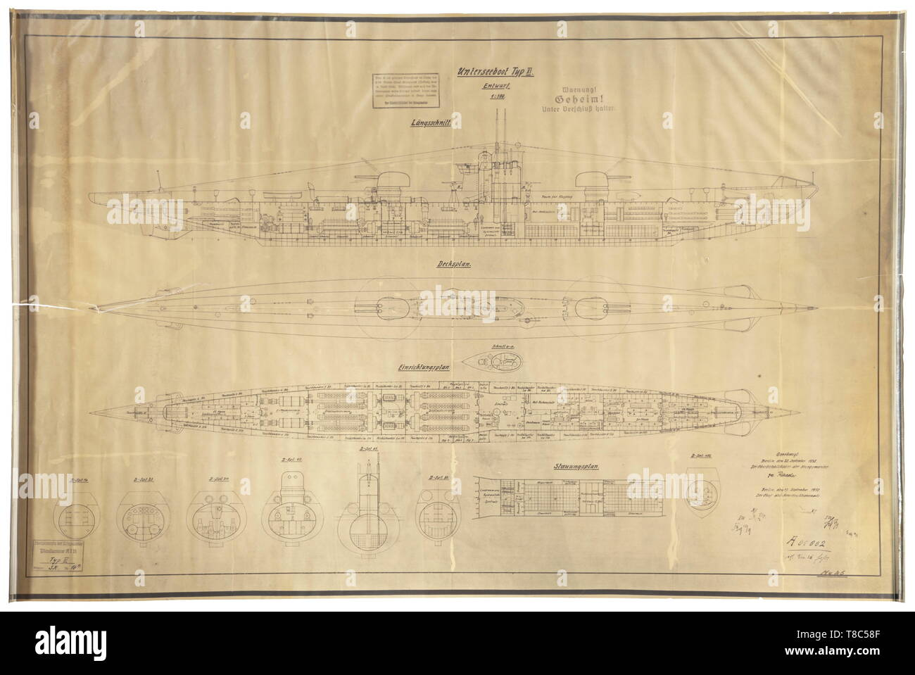 A type XI submarine - a construction drawing with 'Secret' classification for this non-implemented U-Boat cruiser Design in 1:100 scale on transparent paper with longitudinal section, deck, facility and stowage plans as well as seven segment cross sections. At lower right is the approval by Raeder as Kriegsmarine Supreme Commander dated 20 September 1938, and the 'Geheim' (secret) classification with misuse warning. Dimensions 87 x 130 cm, rolled, edge tears. Of great rarity. The U-Boat Type XI was designed as a U-boat cruiser with heavier artillery for use in the Atlantic , Editorial-Use-Only - Stock Image