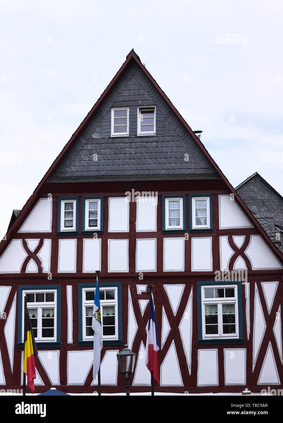 Half timbered house with flags (Bacharach, Germany, Europe) - Stock Image
