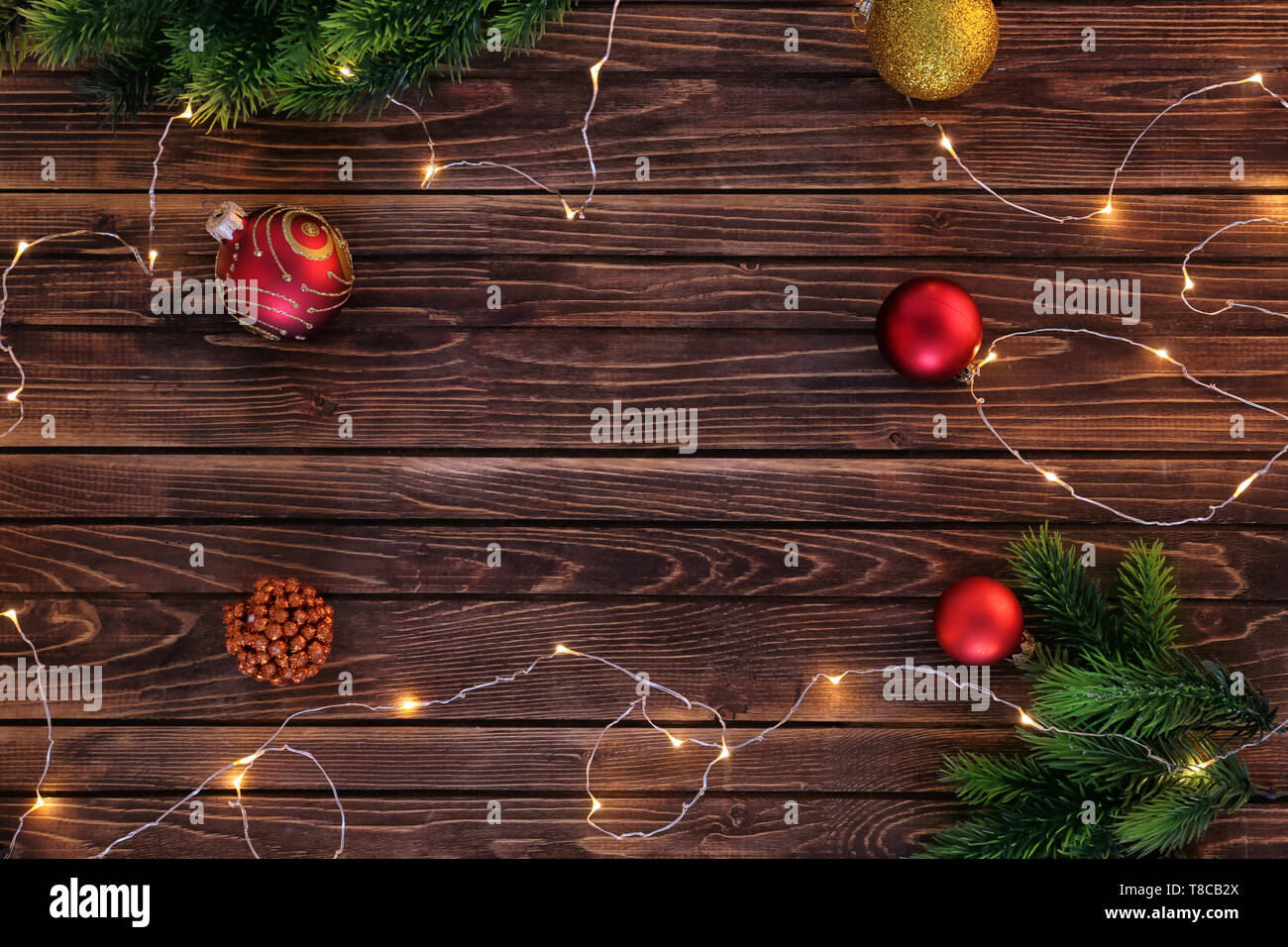 Frame Made Of Christmas Decorations And Fairy Lights On Wooden Background Stock Photo Alamy