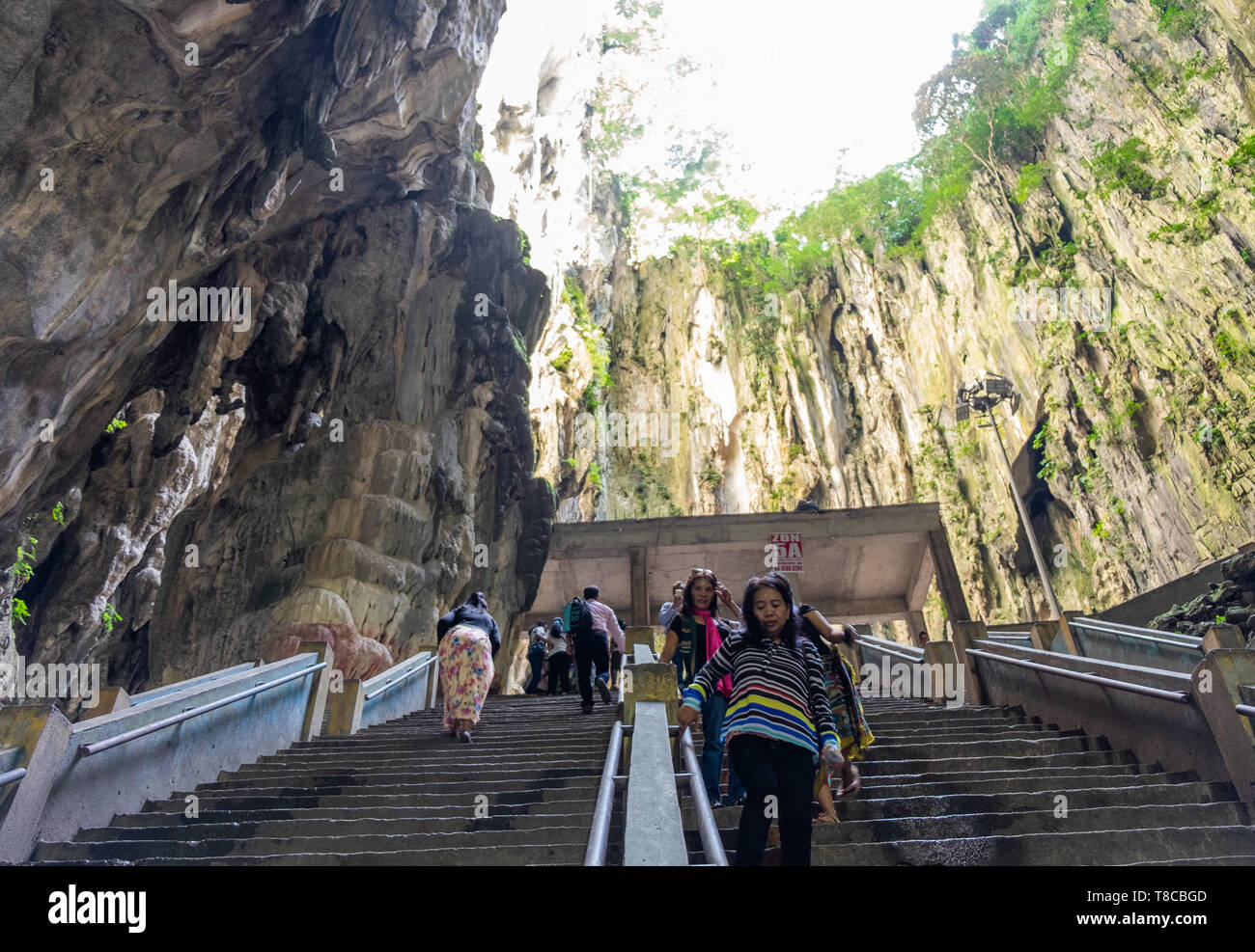 Tourists ascend and descend stairs at Batu Cave, Gombak