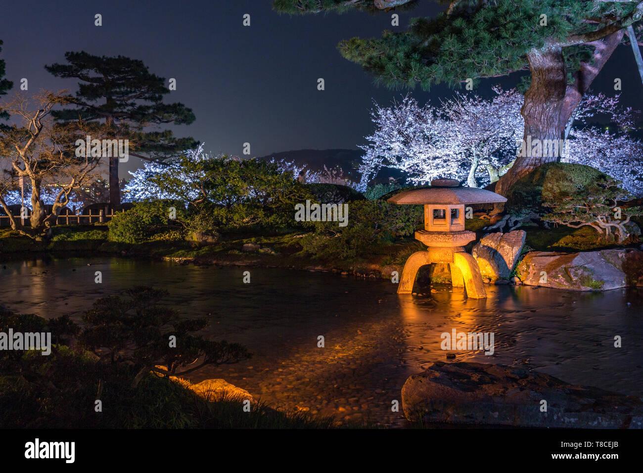 Kenrokuen Gardens By Night With Stone Kotoji Toro Lantern And Trees Reflected In Water Ishikawa Prefecture Western Japan Kenrokuen Is One Of The Stock Photo Alamy