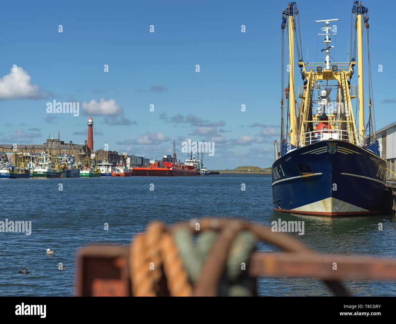 The Port of IJmuiden at Sea where fishing boats unload their precious cargo to the Fish Auction - Stock Image