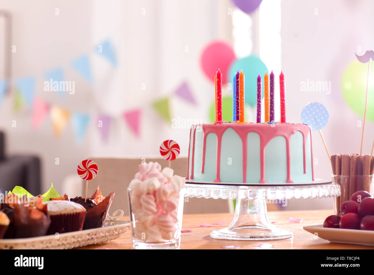 Prime Beautiful Birthday Cake With Candles And Different Sweets On Table Personalised Birthday Cards Petedlily Jamesorg