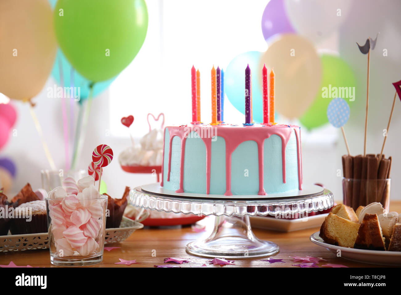 Marvelous Beautiful Birthday Cake With Candles And Different Sweets On Table Personalised Birthday Cards Cominlily Jamesorg