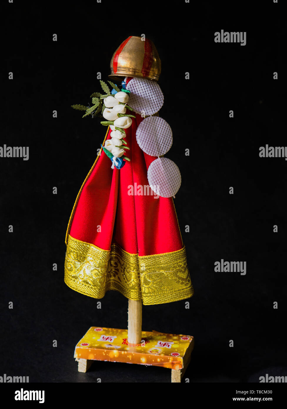 6-Apr-2019-Gudi Padwa a Cosept Gudhi a flag, garlanded with flowers, and neem leaves, topped with upturned copper vessel Kalyan Maharashtra INDIA - Stock Image