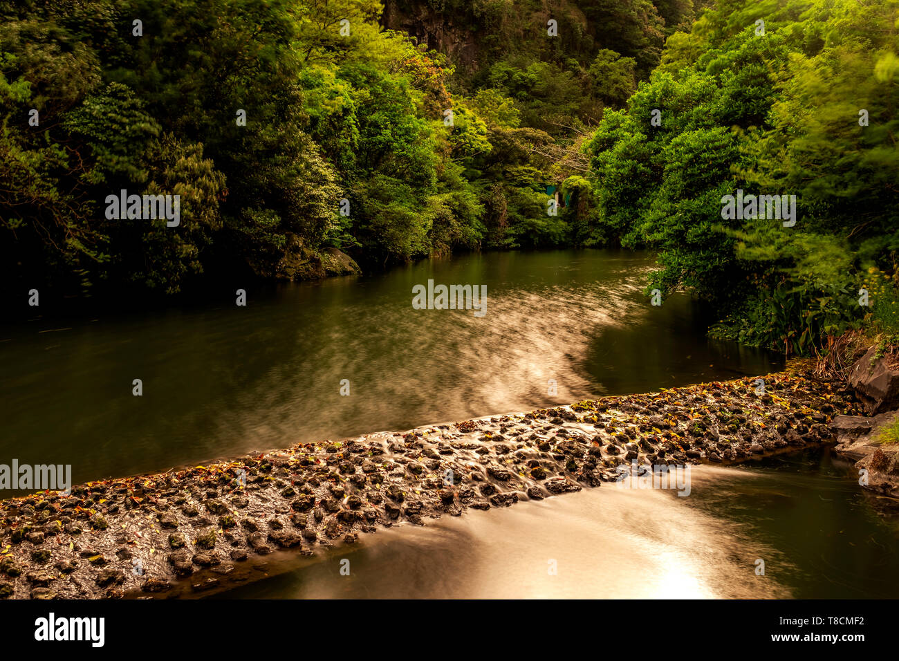 artificial dam in the river, Jeju, South Korea - Stock Image