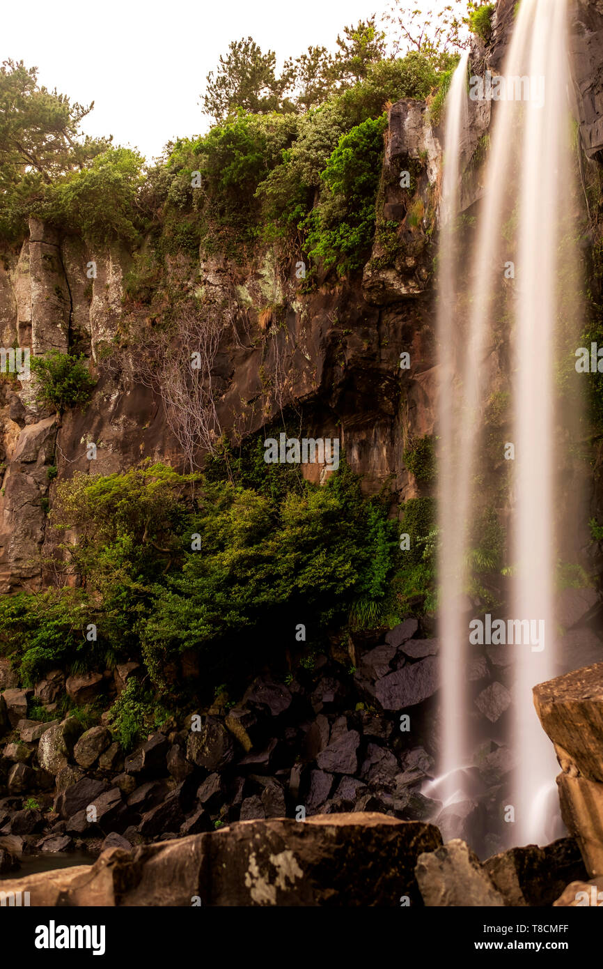 Jeongbang waterfall in Jeju, South Korea - Stock Image