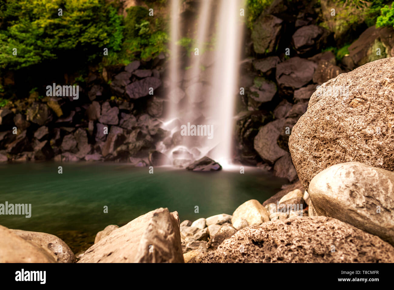 long exposure in Jeongbang waterfall in Jeju, South Korea - Stock Image