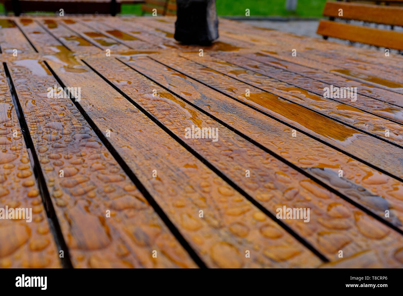 Rain water on an outdoor table - Stock Image